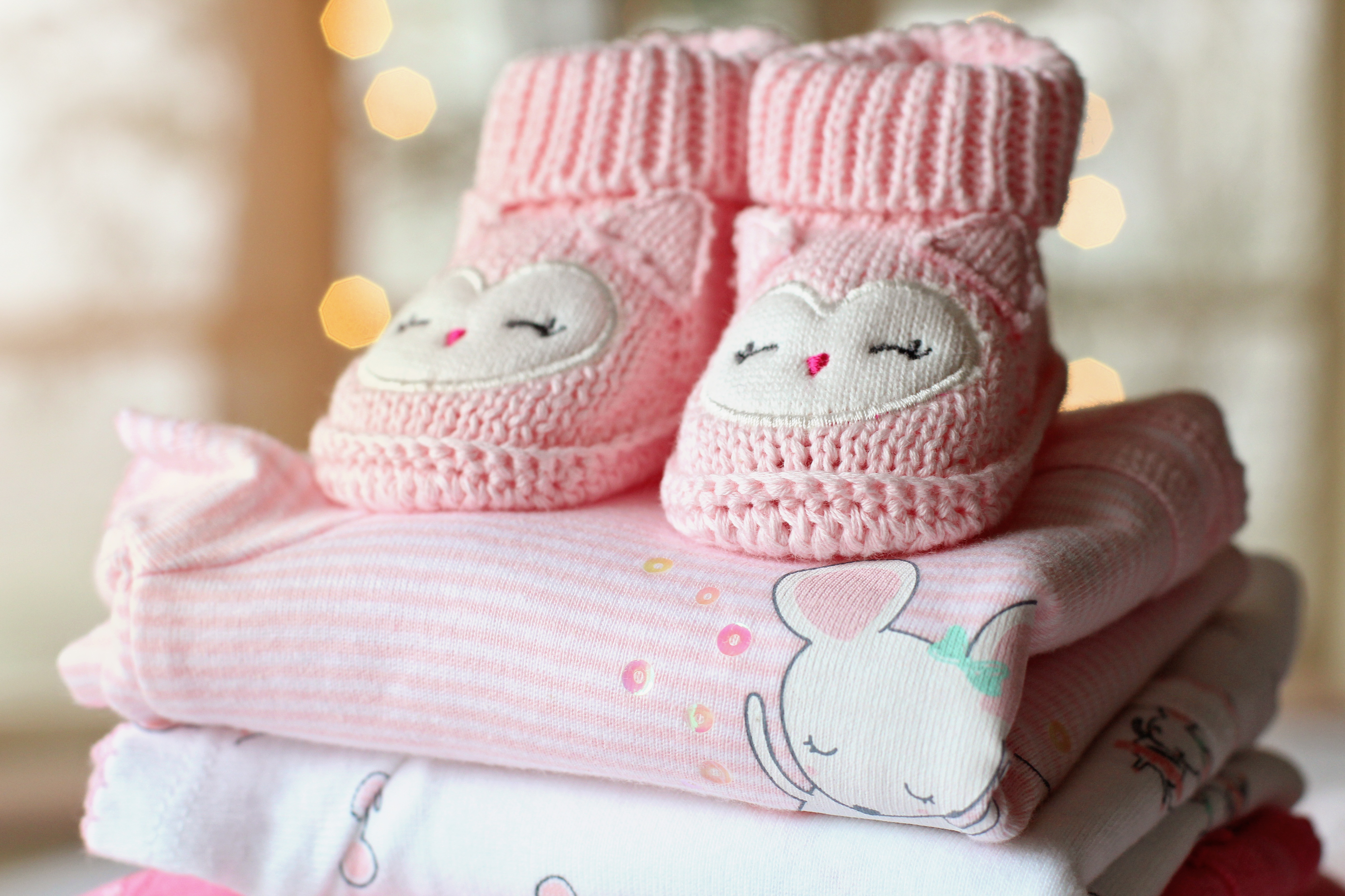 pink baby shoes made with embroidery